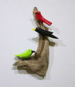 3 Birds Perched on Driftwood